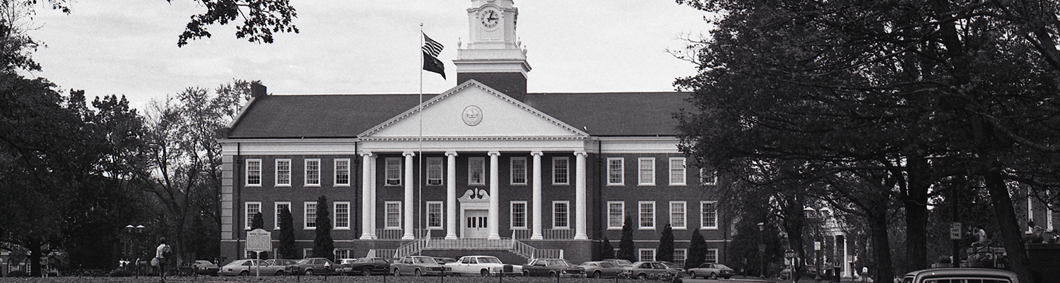 Black and white photograph of the facade of Derryberry Hall from a distance.